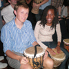 Yaniel enjoys a night of drumming with another study abroad 